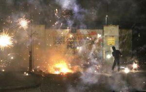Riot activity in West Belfast on April 7. (Peter Morrison/AP)