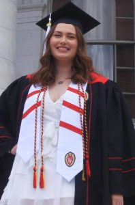 Emily Janicik in graduation robes at Madison capitol